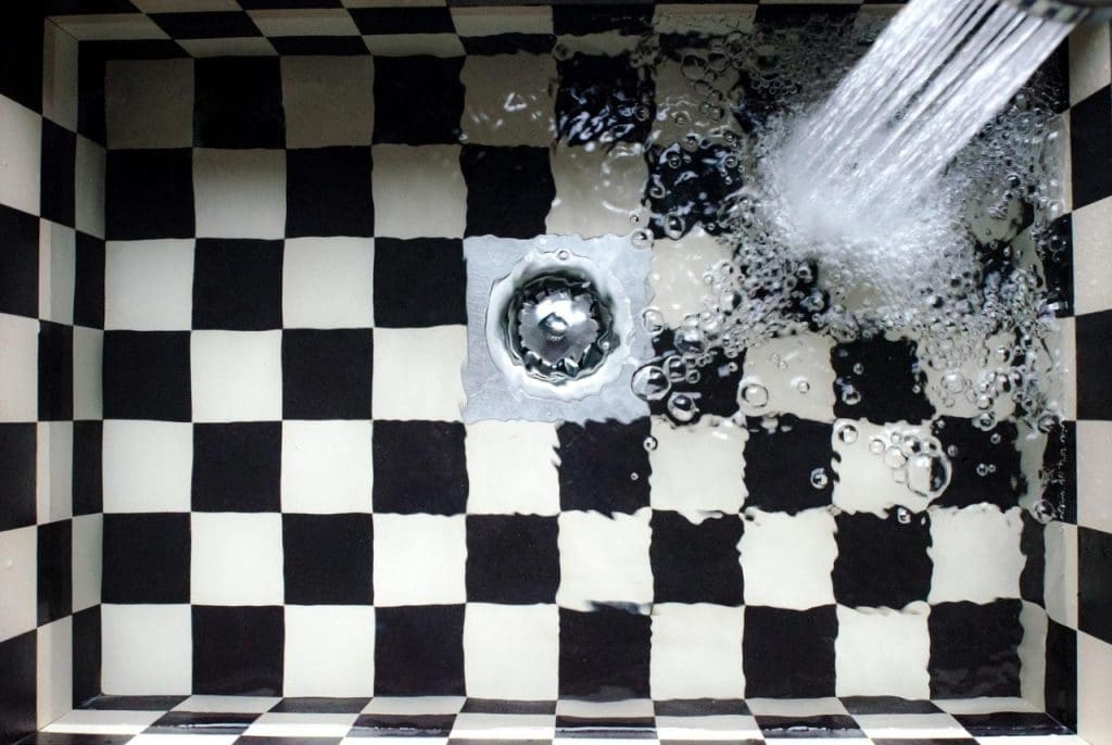 Tiled kitchen sink with flowing water