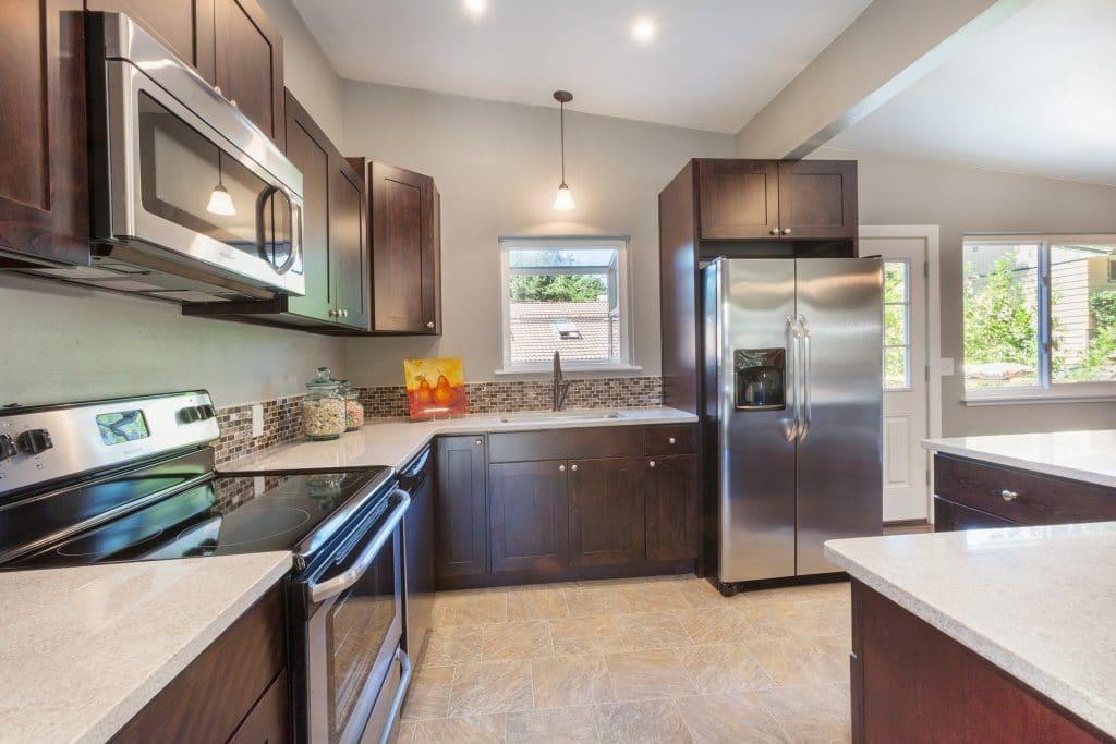 Kitchen full of stainless steel appliances